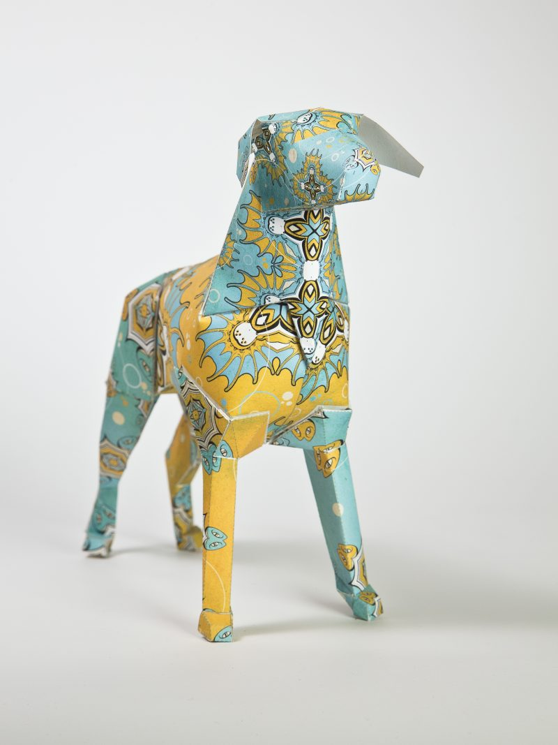 A paper dog sculpture from a design exhibition for Lazerian. The dog has a blue and yellow pattern by artist DBO Dave Bowcutt and is inspired by his time in Egypt (the pattern is inspired by Egyptian lanerns)