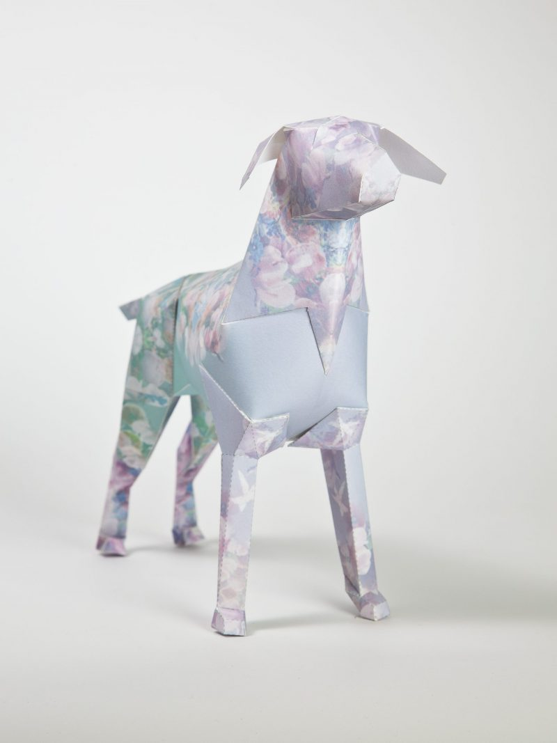 Paper dog model that has a pastel flowery pattern on it.