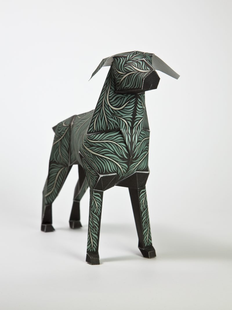 Main view of a paper dog with a green leaf pattern.