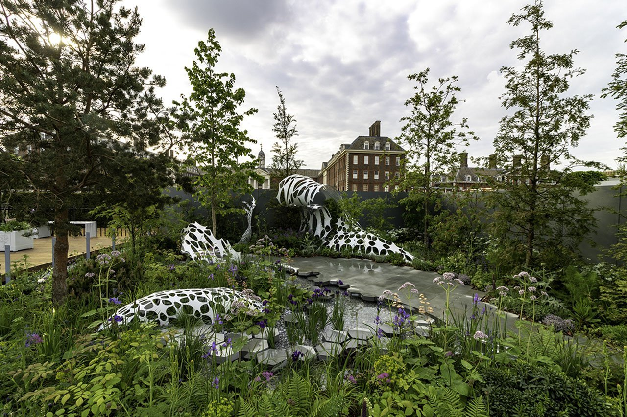 Wide angle of the Manchester Garden at the RHS Chelsea Flower show featuring the carbon fibre art sculpture made using geometric shape forms