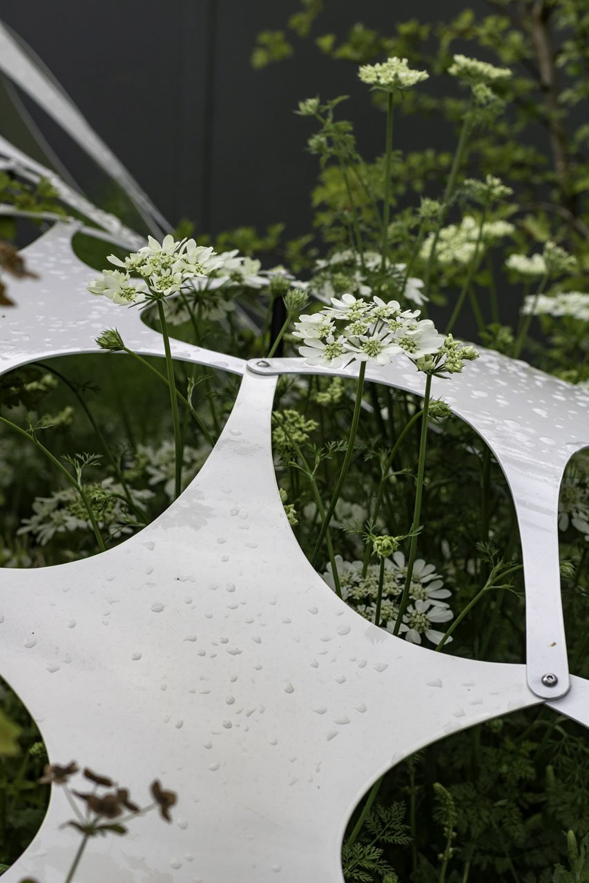 Extreme close up of a carbon fibre geometric shapes as part of a contemporary art sculpture that was diaplyed in the Manchester Garden at the RHS Chelseas Flower Show