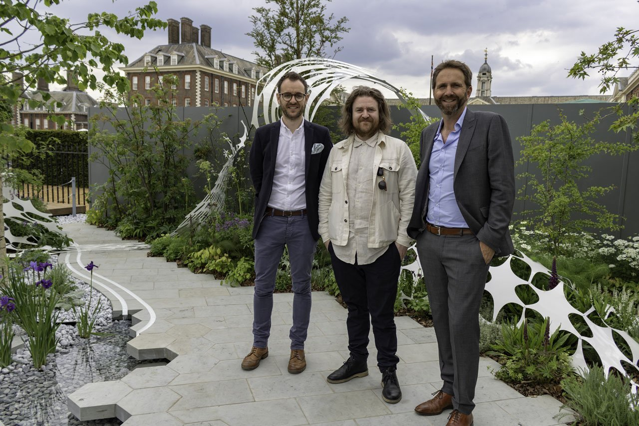 Liam Hopkins of Lazerian and the team at Exterior Architects stood in the Manchester Garden at the 2019 RHS Chelsea Flower Show