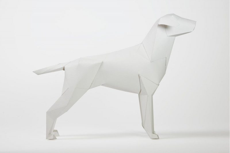 Side view of a paper dog model in a 3D sculptural form. Part of a design project and international exhibition curated by Lazerian who also use the dog as there company logo.