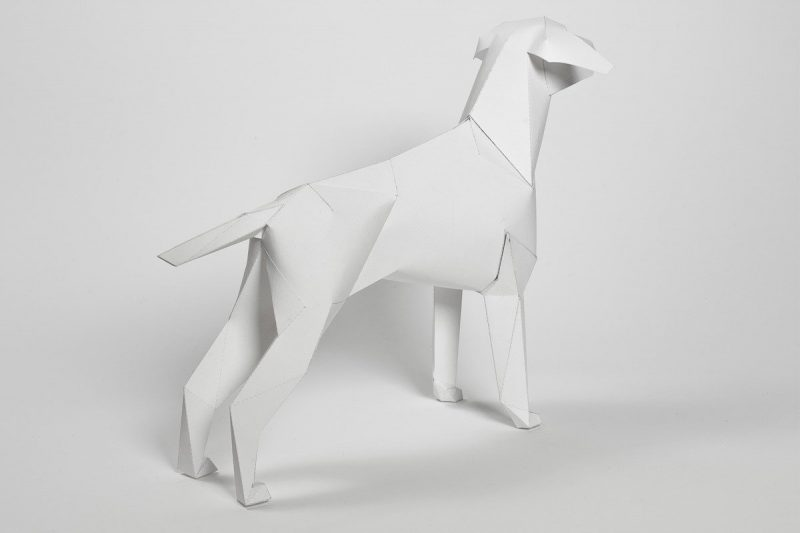 Right hand view of a plain white paper dog model in a 3D sculptural form. Created by design studio Lazerian as part of an international exhibition