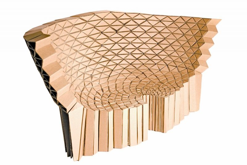 Large seat with back designed and created using cardboard. Made with individual creative components which are them seamlessly glued together.