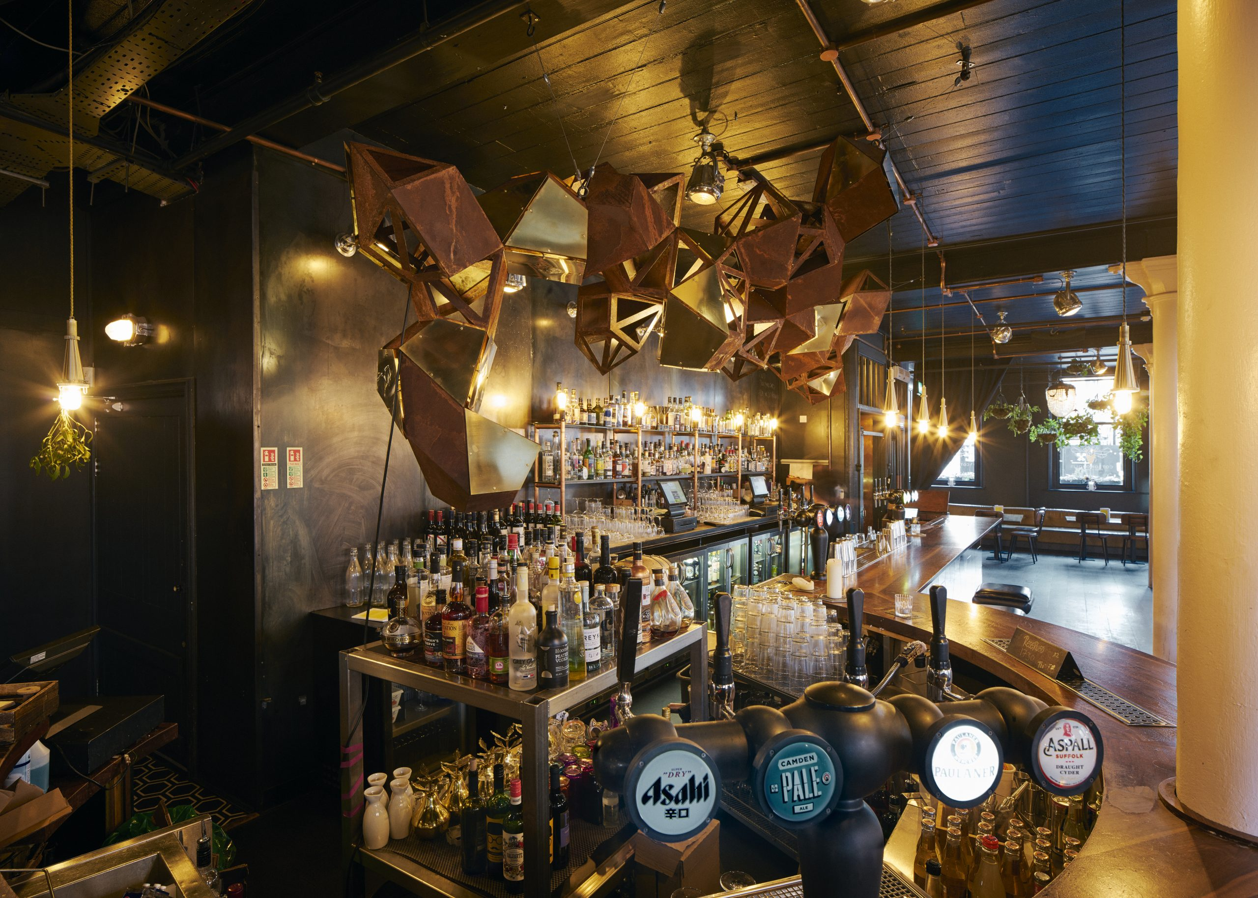 A side view of the metal sculpture from design studio Lazerian located over the bar in Manchester bar Cottonopolis