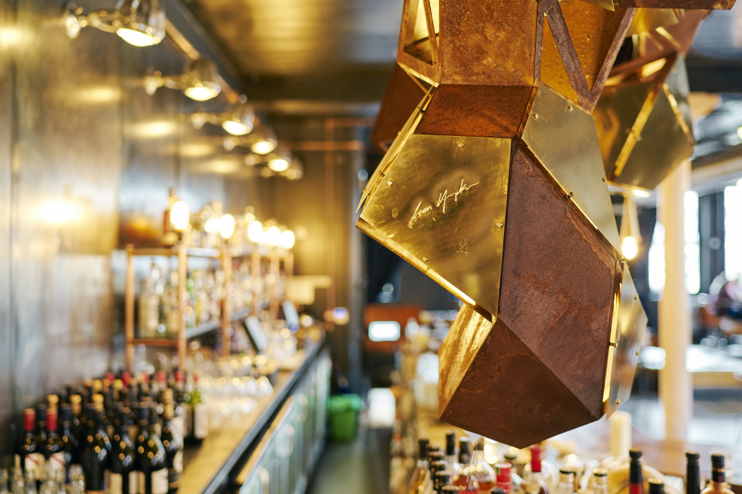Close up of public art sculpture designed by Lazerian. positioned over the bar in Manchester bar and restaurant Corttonopolis