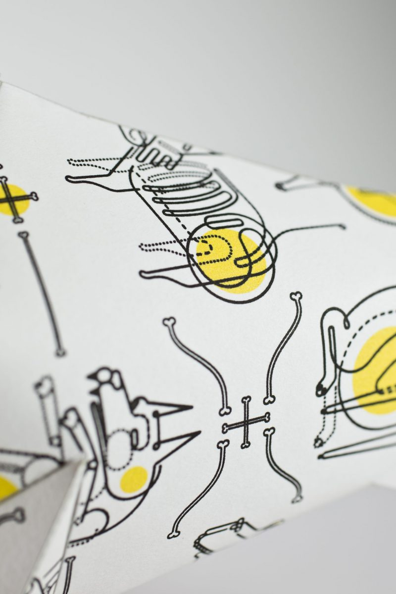 Black and yellow print on a paper dog model from design studio Lazerian