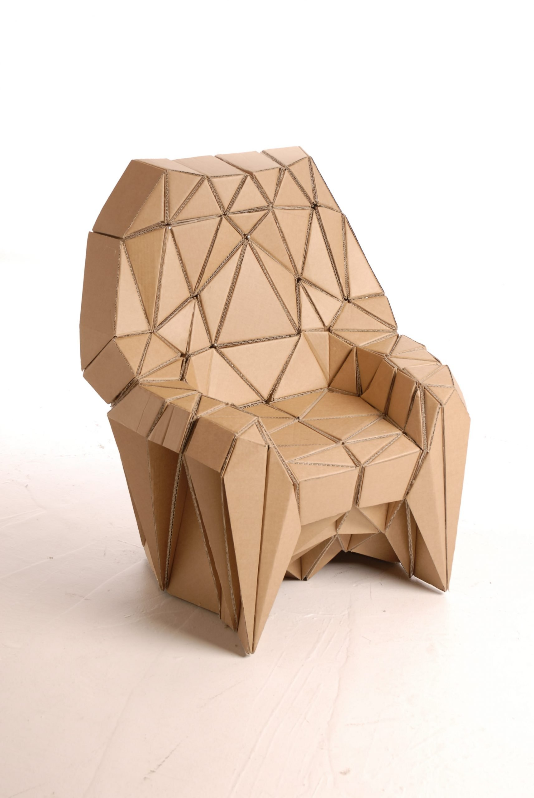 Cardboard chair made of thousand of creative cardboard individual triangular components that were glued together. Designed and created by design stuido Lazerian as part of their honeycomb series of furniture