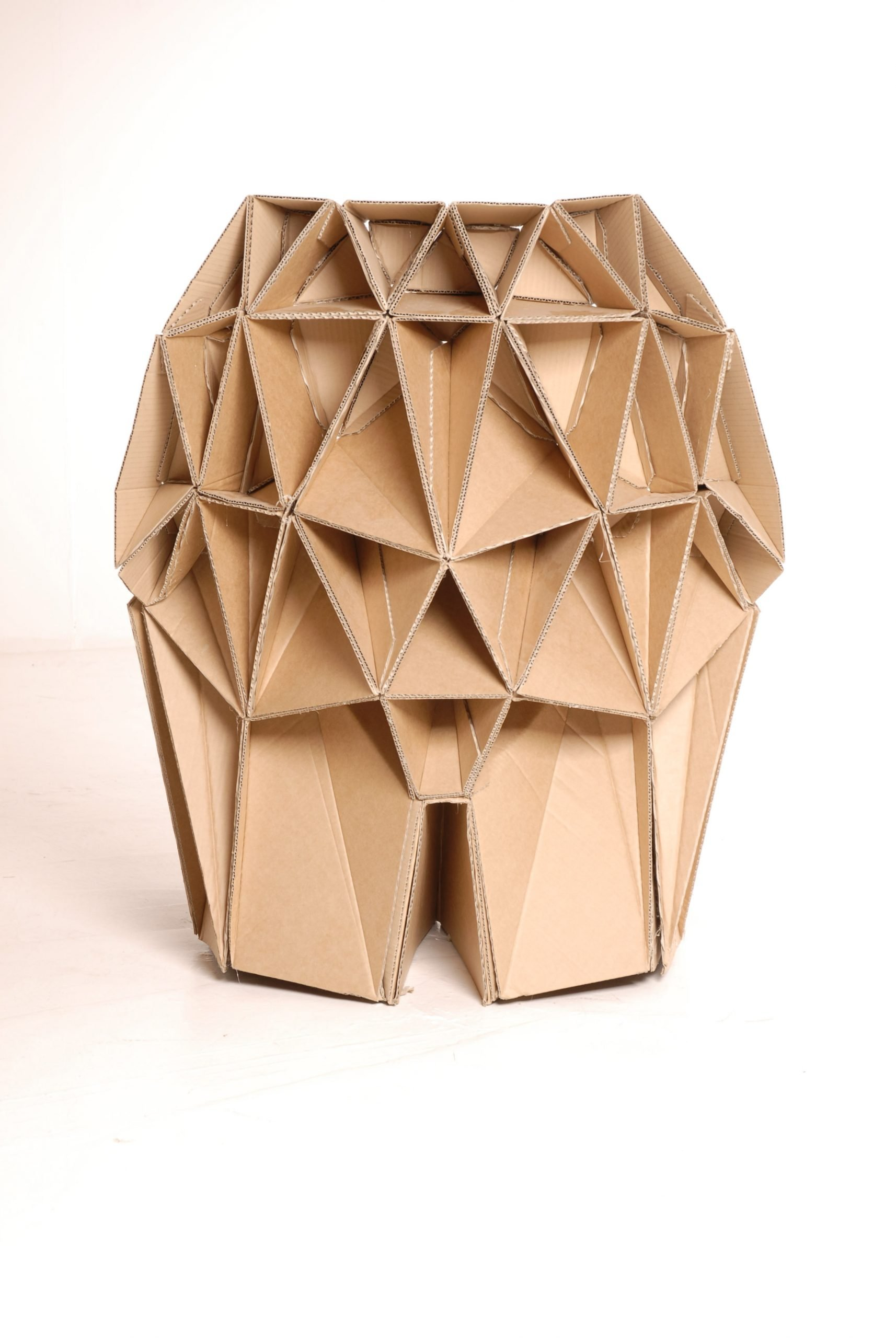 Back of cardboard chair made from thousands of creative triangular components by design studio lazerian