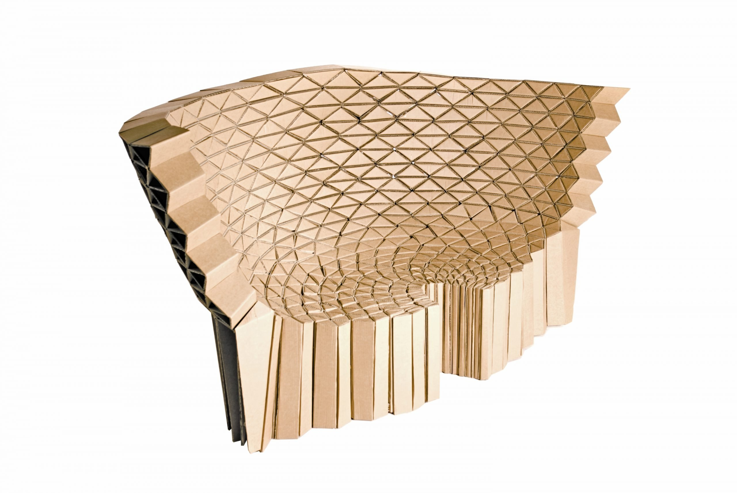 A creative artistic cardboard furniture design of a sofa created using thousands of triangular components all individually cut and glued together. The sofa is from design studio Lazerian and part of the honeycomb collection.
