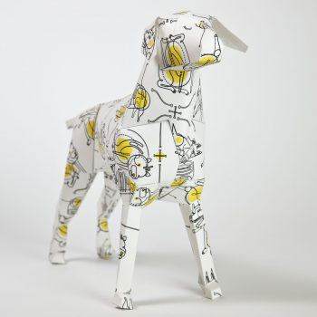 Front view of a paper dog model with a yellow and black pattern by Will Scobie. The dog is a mascot of design studio Lazerian