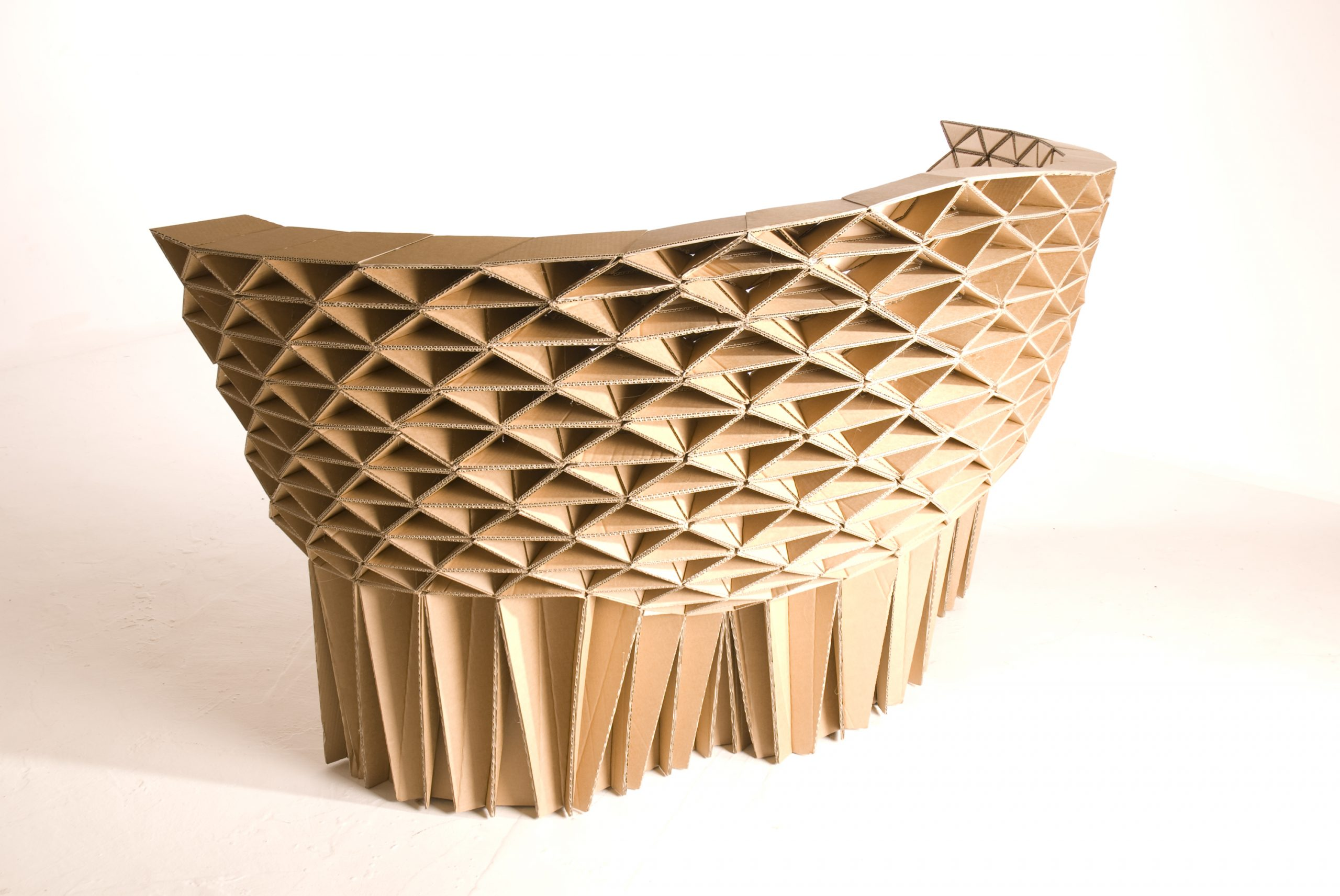 Back of a creatively designed cardboard sofa created using thousands of triangular components. Part of the honeycomb collection by design studio Lazerian