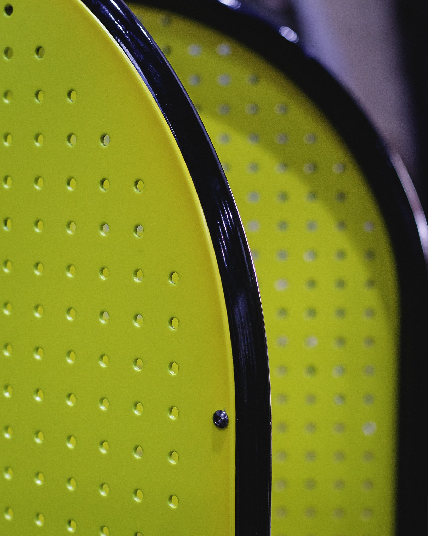 illumines florescent yellow luggage trolleys with a black piping round the edge