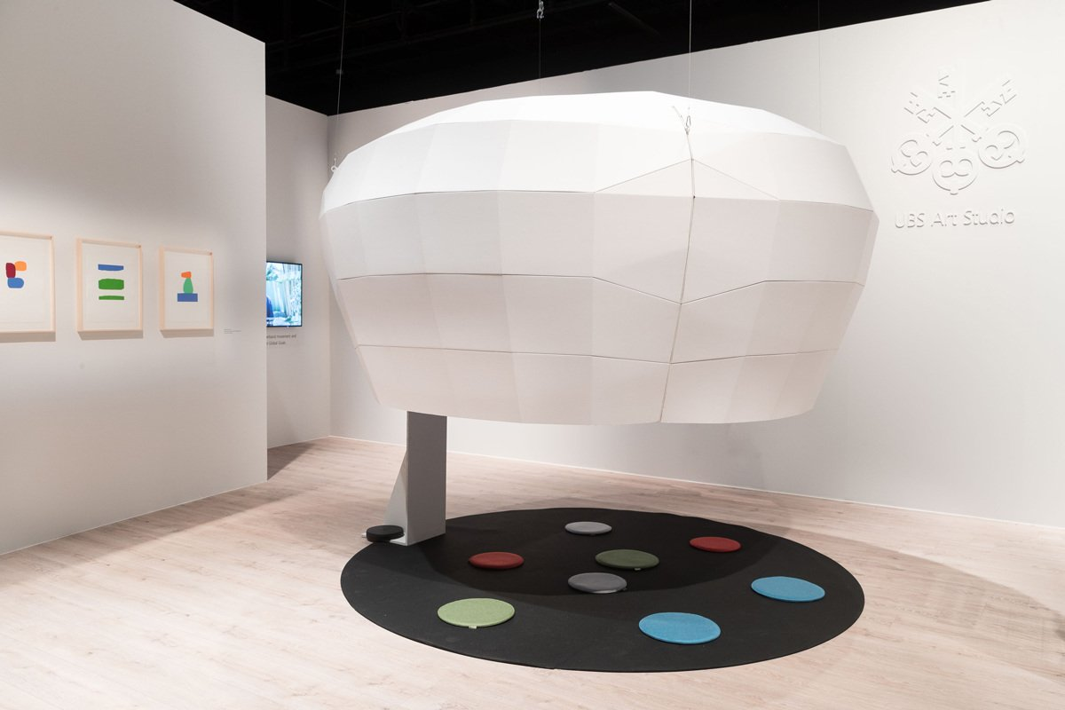 Cinema style pod made from white cardboard paper material. Displayed in Art Basel by design studio Lazerian