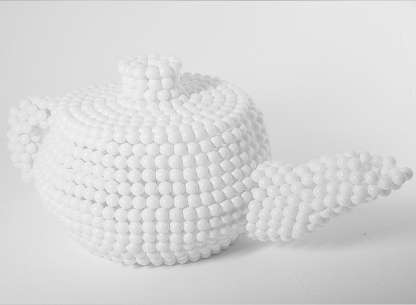 White teapot sculpture created using ping pong balls. Designed and made by lazerian for a ping pong exhibition