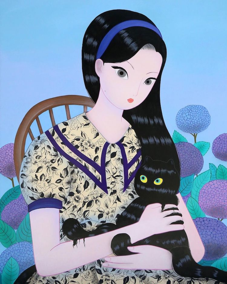 An illustration from the latest collection of Korean artist Jang Koal. There is a illustrated image of a lady with cat like eyes. She is against a purple and blue flowered background. The woman has long dark black hair but within the hair are two hidden cats. The purpose of this image is to show the type of work that Jang Koal creates